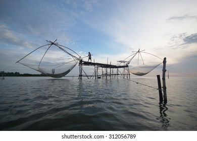 Fisherman of Pakpra Lake in action when fishing in the morning, Thailand