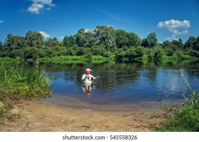 Fisherman performs casting rod