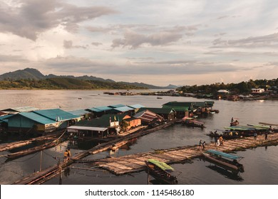 The fisherman raft village of Mon people in Sangkhlaburi district Kanchanaburi province Thailand on 18 November 2017 at 4.50 pm. Sunset time