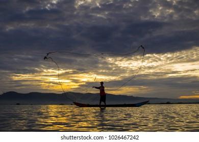 fisherman at rawapening lake, central java, indonesia