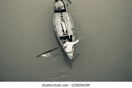 A fisherman riding a boat in the river unique photo