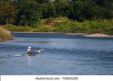 The fisherman is riding a motor boat on the river at Vang vieng, Laos