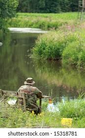 Fisherman at a river in Bavaria, Germany