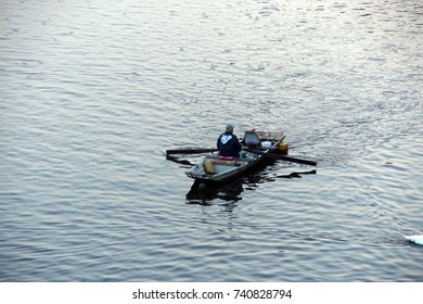 Fisherman in rowboat on the Vltava river in early morning  Prague, Czech Republic