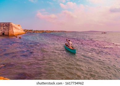 a fisherman sailing in his daily work sailing alone and without fear in the great caribbean sea