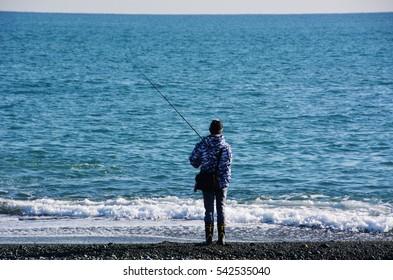 Fisherman in a sandy beach