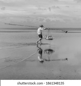Fisherman at Sea after a morning of fishing. Near Bac Lieu city. Nha Mat village. Morning view. Vietnam (black and white)