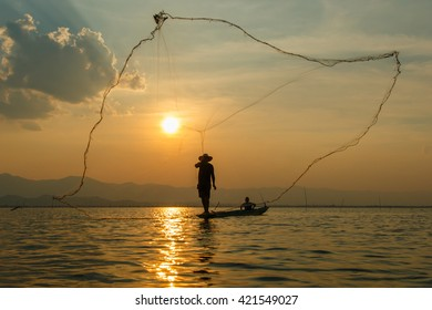 Fisherman , Silhouette fisherman with net at the lake in Thailand (kwan phayao) Phayao.