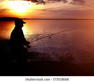 Fisherman silhouette in sunset