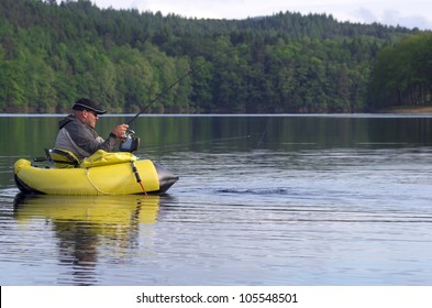 A fisherman sitting in his float tube fight against a pike
