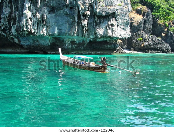 Fisherman Sleeping in Traditional Long Tail Boat