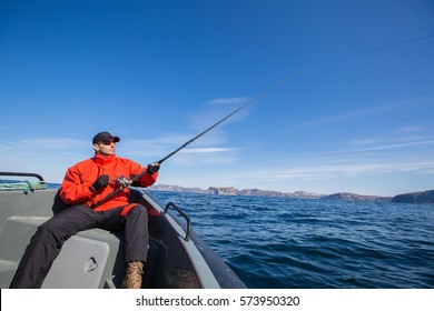 Fisherman sportsman sunglasses fishing in the sea. sea fishing
