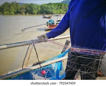 Fisherman is taking the nets up from the sea at Koh yao yai,Thailand
