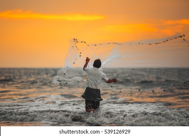 Fisherman throws his net. Arabian Sea.India.