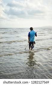 fisherman using trawl for catchig fish at beach