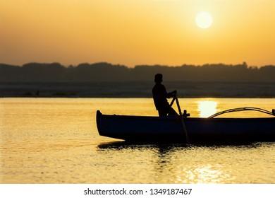 fisherman in Varanasi, Ganges by sunrise