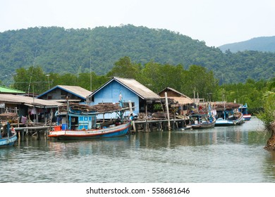 Fisherman village in Asia with green mountain