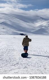 Fisherman walking on the frozen Cildir Lake (Cildir Golu) in Ardahan, nearby Kars, Turkey.