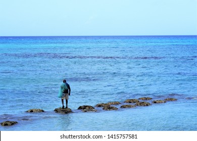 A fisherman working with his net in the Caribbean Sea