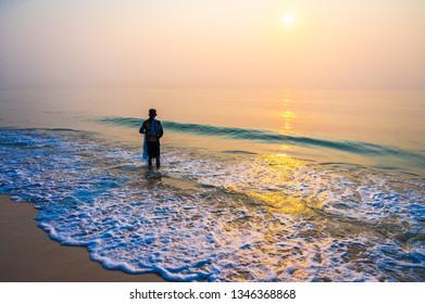 Fisherman working on the beach