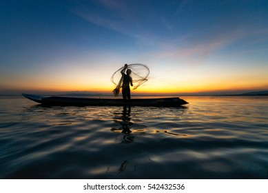 Fishermans in action when fishing at sunset time,Asia,Thailand