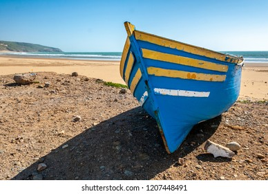 Fisherman's boat stranded on the beach of Tafelney, in the region of Essaouira in Morocco