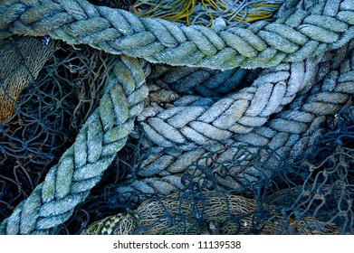 A fisherman's ropes and nets, piled on a wharf