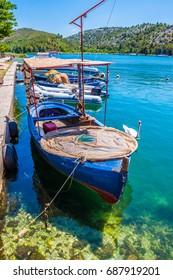 Fishermen boats in the harbour of Skradin in Croatia