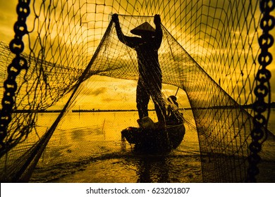 Fishermen catch fish on a boat in Asia