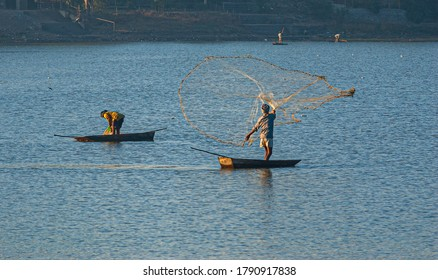 Fishermen catching fish at lake in Dhar city of madhya pradesh state. India.