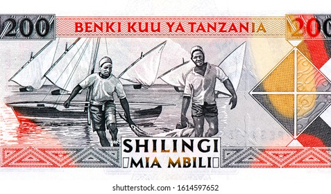 Fishermen caught big fish; sailboats. Portrait from Tanzania 200 Shillings 1993 Banknotes. An Old paper banknote, vintage retro. Famous ancient Banknotes. Collection.