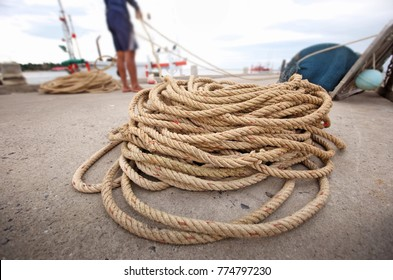 Fishermen are collecting ropes at the pier.