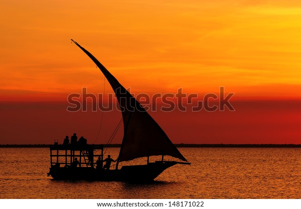 Fishermen Dhow Boat coming back home at sunset from a long day in the sea. Taken at Nungwi village, Zanzibar Island, Tanzania
