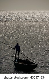 Fishermen in fishing boat - silhouette
