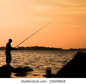 Fishermen fishing in jeddah red sea at sunset