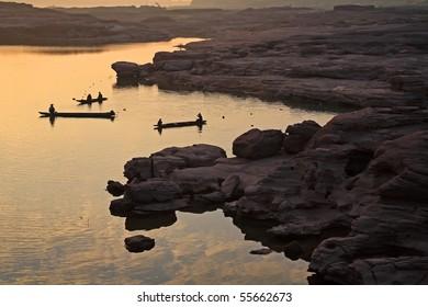 Fishermen fishing in the Mekong River. Three thousand waving, Ubon Ratchathani, Thailand.