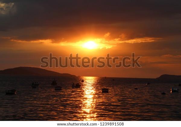 fishermen-fishing-sunset-600w-1239891508