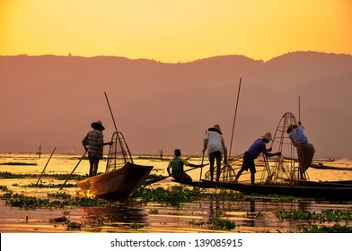 Fishermen in Inle lakes sunset, Myanmar. Fishermen is finish a day of fishing in Inle lake, Myanmar (Burma). Inle is one of the most favorite tourist places in Myanmar (Burma)