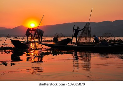 Fishermen in Inle lakes sunset.Fishermen is finish a day of fishing in Inle lake, Myanmar (Burma). Inle is one of the most favorite tourist places in Myanmar (Burma)