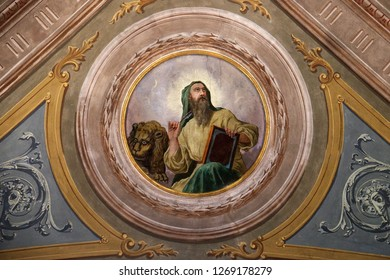 FISHERMEN ISLAND, ITALY - JUNE 25, 2018: Saint Mark the Evangelist, ceiling fresco in the church of St. Victor on the Fishermen Island, one of the famous Borromeo Islands of Lake Maggiore, Italy