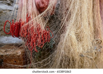 Fishermen nets hanging on a wall on Fisherman's Island, Italy, Lago Maggiore (Grand Lake)