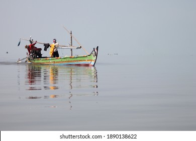 fishermen on the beach kenjeran surabaya, east java