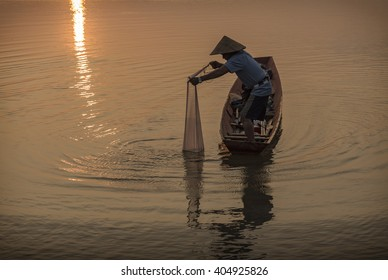 Fishermen on boat fishing at river