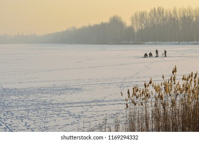 Fishermen on the frozen lake