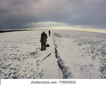Fishermen on ice, Nida, Lithuania