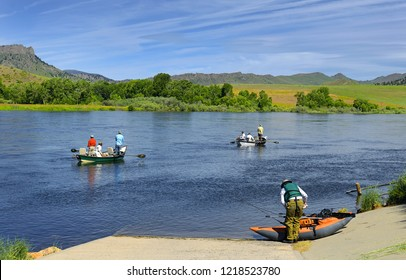 Fishermen on the Missouri River near Wolf Creek Bridge on Old U.S. Highway 91, Montana, USA