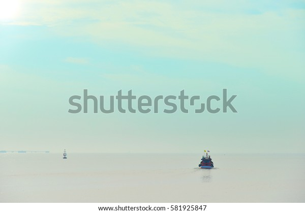 The fishermen are out fishing with a fishing boat in the Gulf of Thailand.