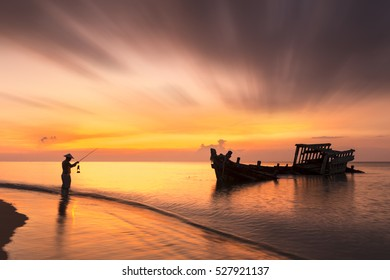 Fishermen out fishing on sea has ancient ship disintegrated and sea colorful beautiful.