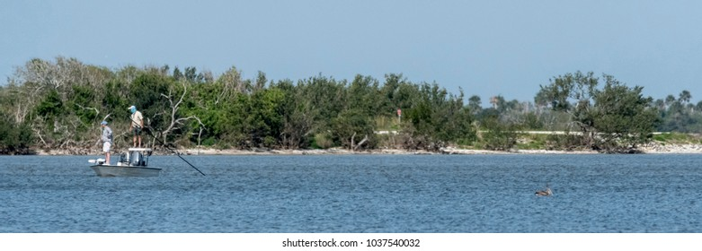 Fishermen in a shallow inlet of the Eastern Shores of Florida