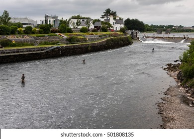 Fishermen standing in the river in Galway